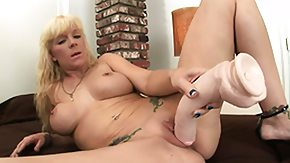 HD Huge Dildo Sex Tube Tattooed blonde with amiable tits uses a huge ding-dong in her unlighted opening